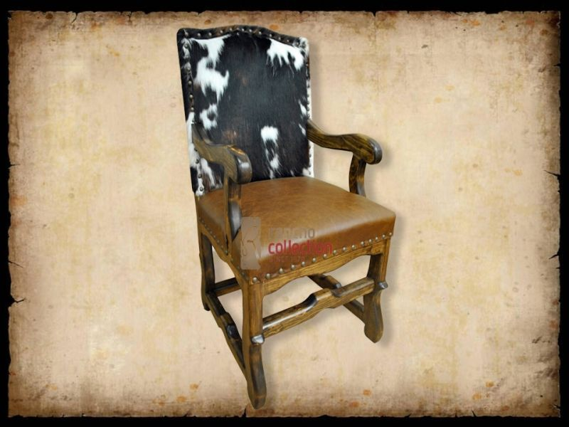 Austin Chair w/ arms. dark walnut stain, corona leather seat, brindle hide front and back, and natural nail heads