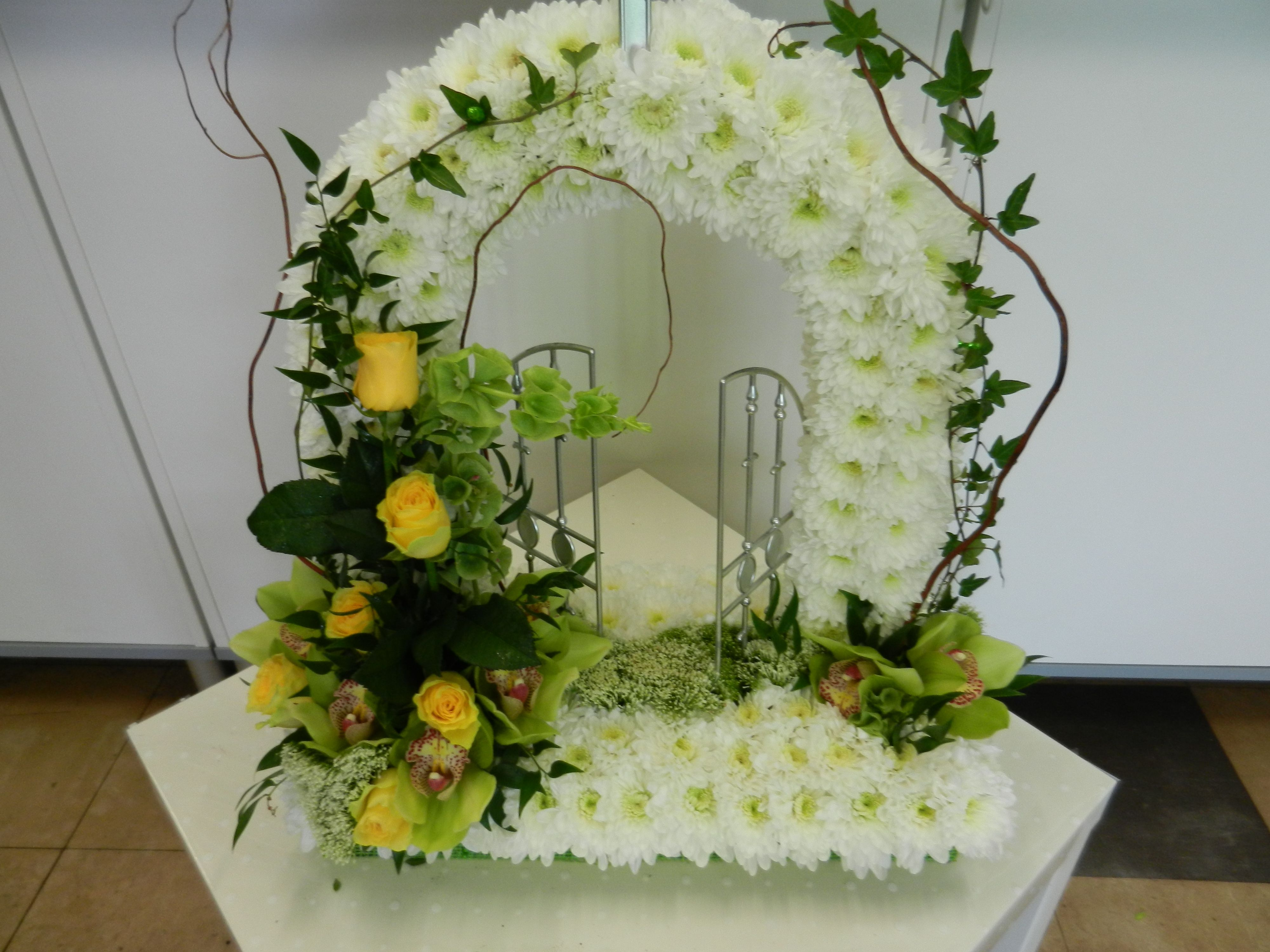 Gates of heaven flower arrangements pinterest funeral tributes gates of heaven santa ana funeral tributes sympathy flowers swansea funeral flowers izmirmasajfo