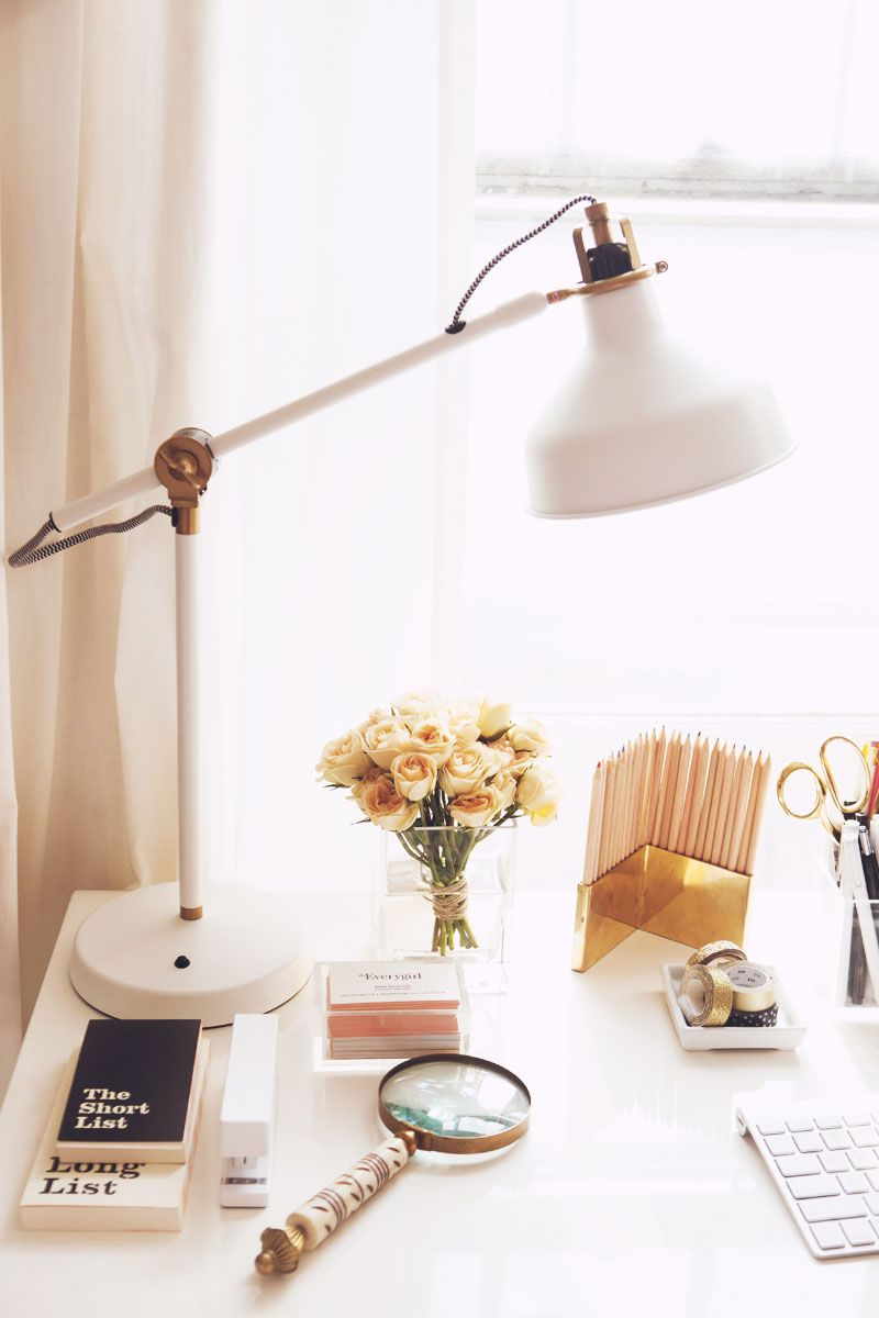 Chic Office Desk With A Gold And White Table Lamp, Fresh Flowers And Gold  Accents