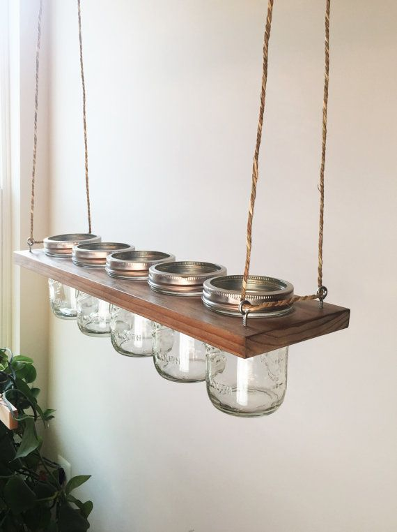 Horizontal Hanging Mason Jar Planter  This is great for planing herbs and small plants. Can also be used for decorations, storage and candle holders. Would be beautiful with candles over a rustic table.  Item is stained Antique Oak and includes (5) 16oz Wide Mouth Clear Ball Mason Jars. Also includes Twine for mounting to the ceiling.  20L X 5.5W X 5H