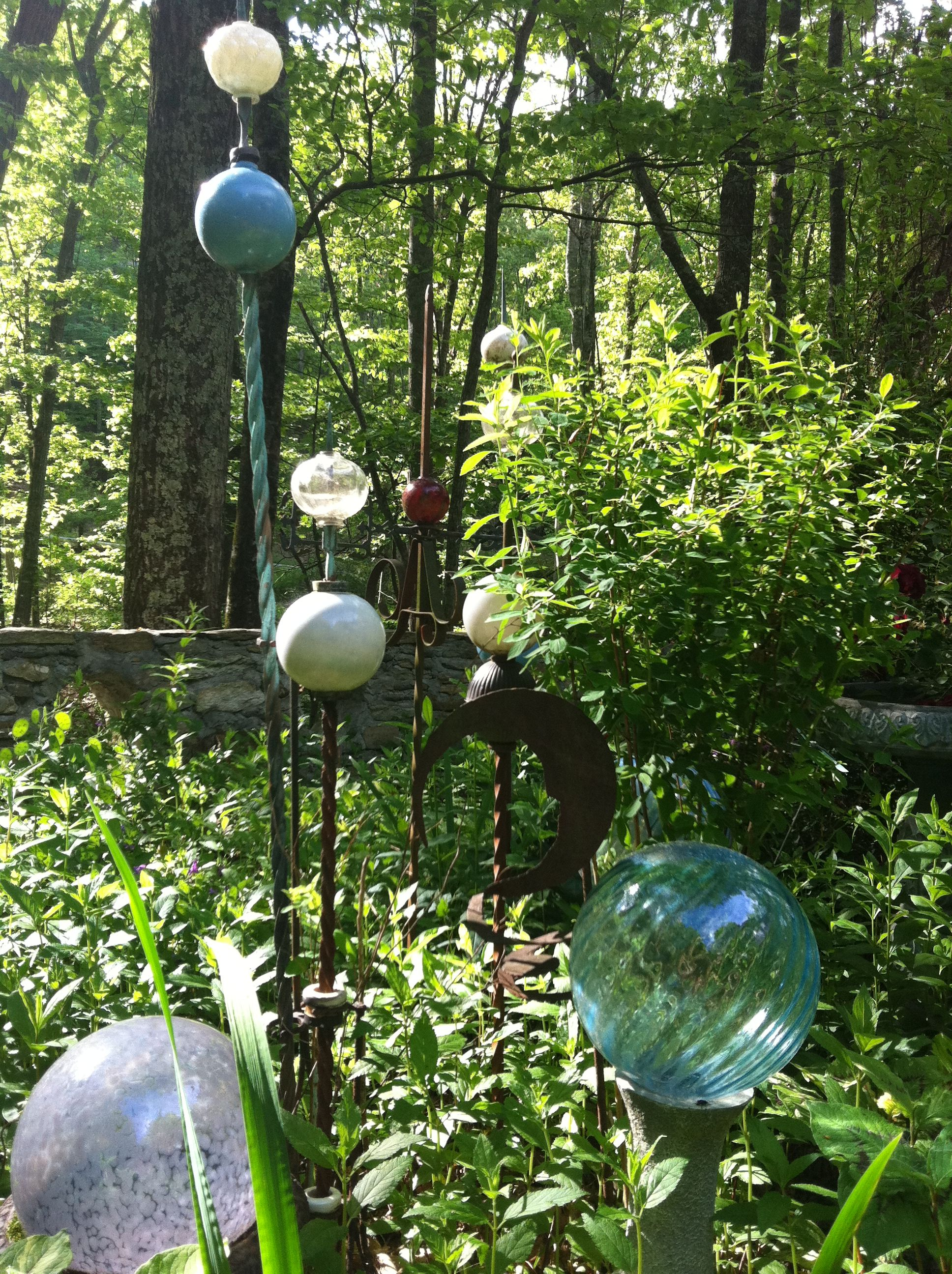 Garden glass collection. I\'ve stacked lamp parts, copper balls, and ...