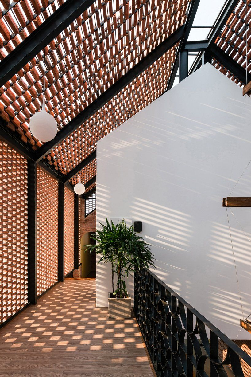 block architects encloses three-part house in vietnam with patterned brick shell
