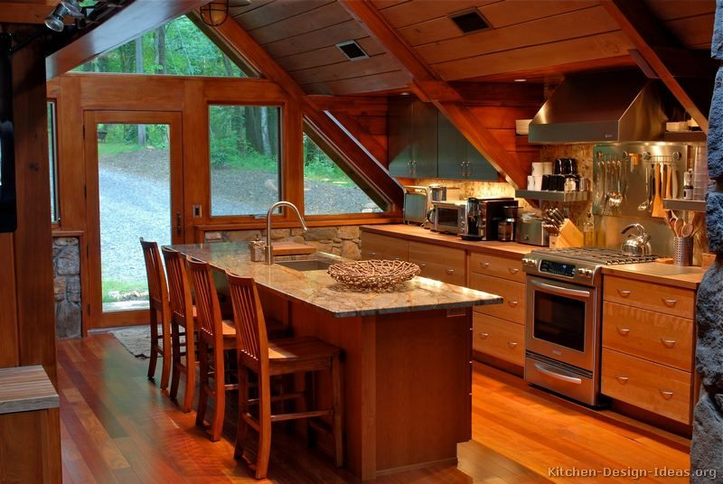 A Wood Cabin Kitchen With Vaulted Ceilings Small Cabin Kitchens