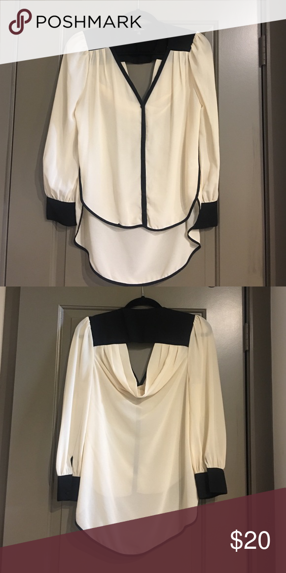 Cream blouse Cream blouse with open back, never worn from boutique the clothing company  Tops Blouses