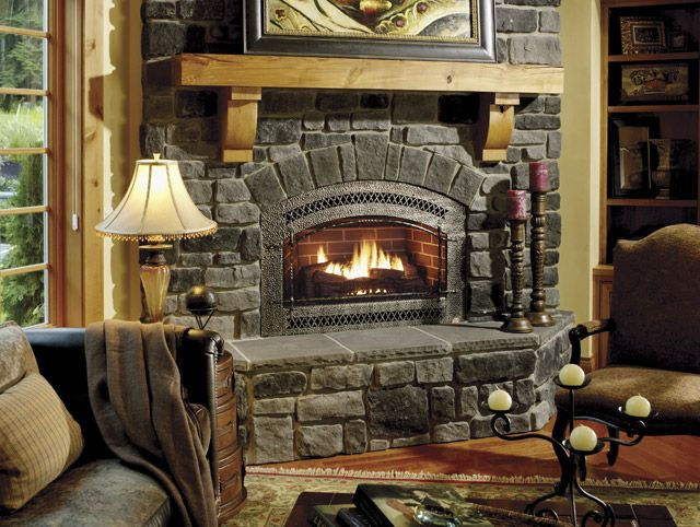 Cozy Living Room With Stone Fireplace And Hearth Light Wood Mantle Stone Fireplace Designs Cozy Living Rooms Fireplace Design #stone #fireplace #in #living #room