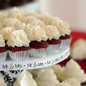 Mini red velvet wedding cupcakes on a tier from The Chocolate Moose ...