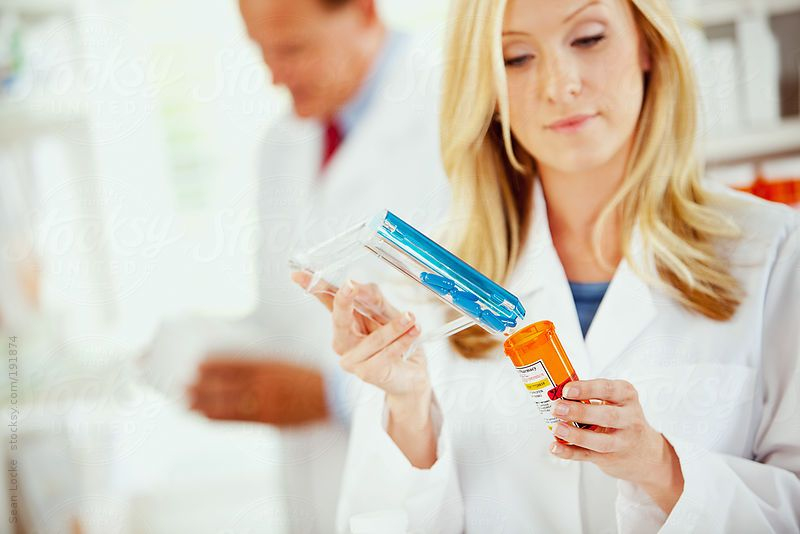 Pharmacy Pharmacist Pouring Medication Into Bottle by