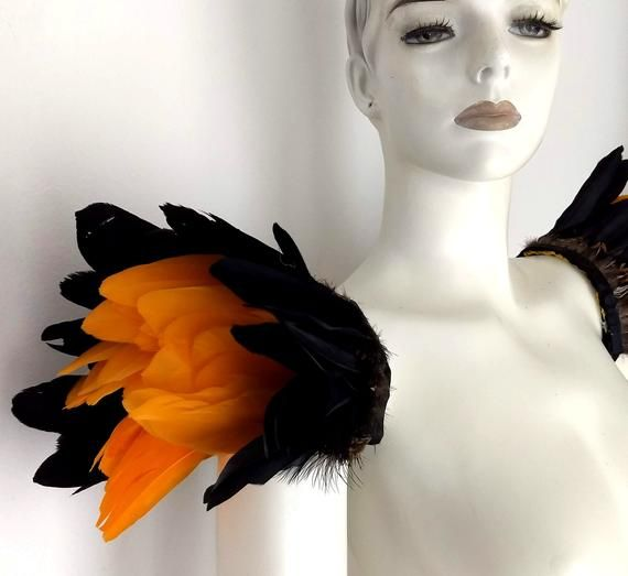 We make and ship our items really fast if you need it for a specific date please let us know. or call/text us at 954-3051817 to complete your order over the phoneHand made to order in Miami FloridaFeather epaulets made with 2 color fathers plus a fancy feather detail Elastic straps secure them to your shouldersA miamifeathers originalAll the items are new!Available in many color combinations and in all quantitiesThe fancy feather will match one or both duck feather colors..................Please