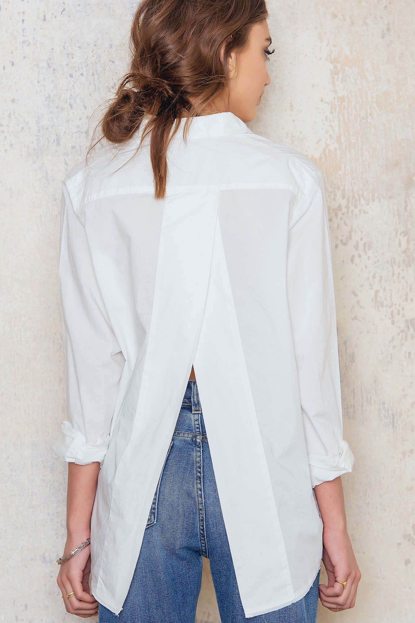 9ced56eef0d5d The white shirt with a twist! The Disarm Shirt is oversized with raw ...