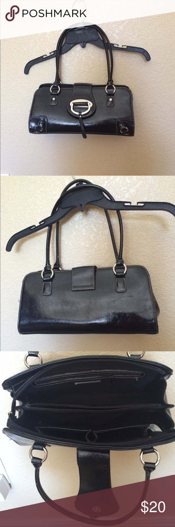 Cute Hillard and Hanson long black purse Black purse with zipper and cute fold over magnetic button to close the purse. Inside the purse is a zipper compartment on one side and two pockets on the other side. In the middle of the purse is another zipper compartment that runs the length of the purse. No visible flaws. Perfect for casual and dressy outfits. Hillard & Hanson Bags Shoulder Bags