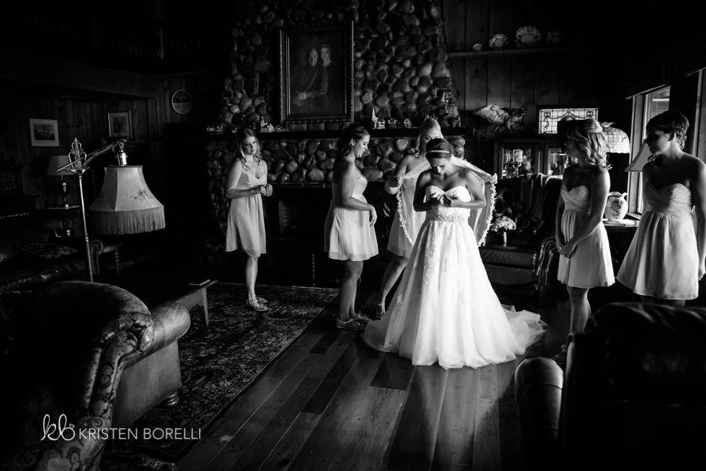 Bridesmaids Getting Bride Into Her Dress Kristen Borelli Photography Victoria Wedding Photographer Pine