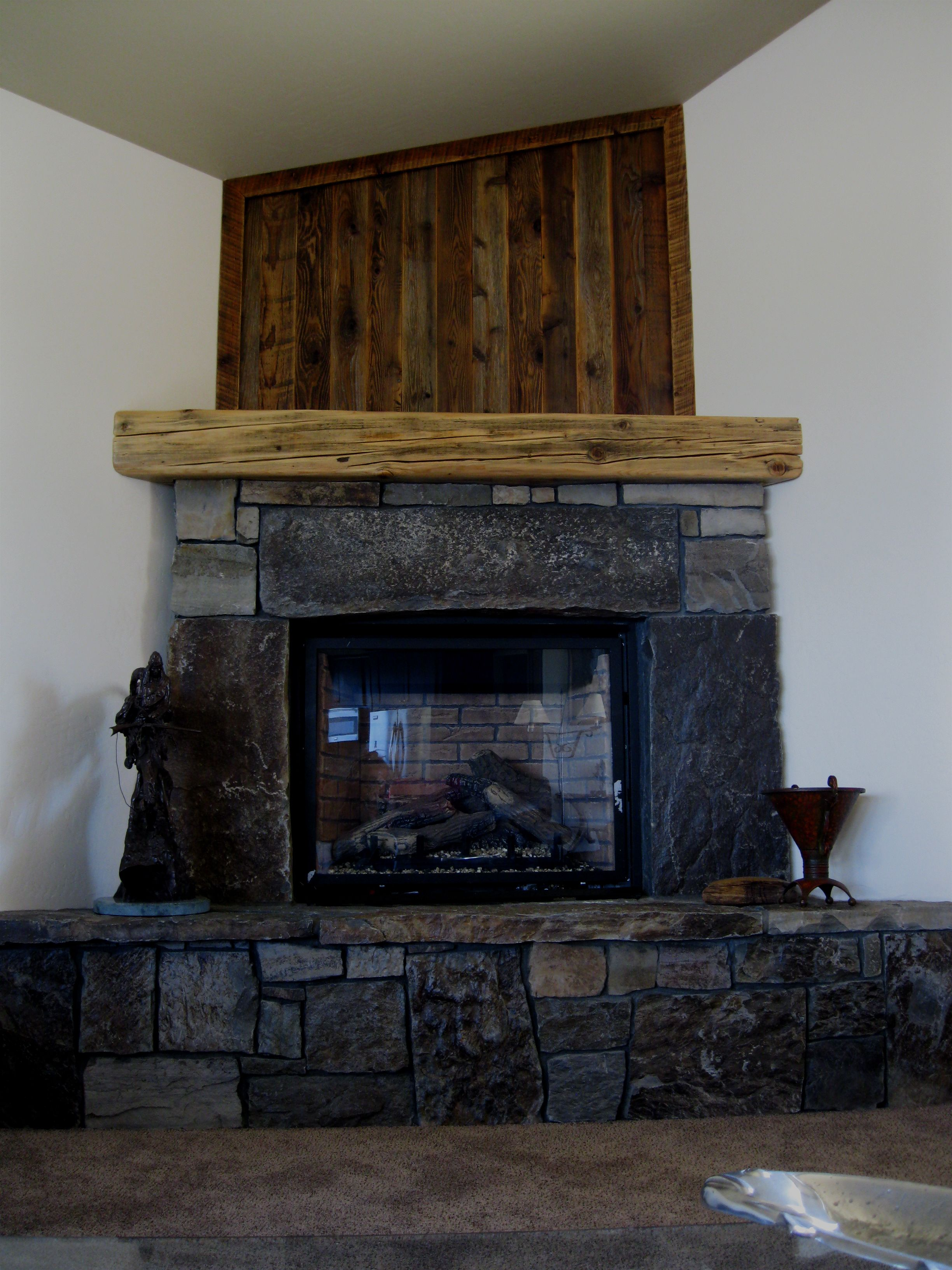 Reclaimed Mantle & Wood Above New Birth Woodworks