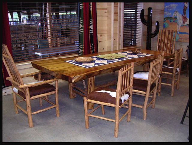 One of a kind, but everything Paul Kendall is one of a kind.  The Cypress used in this table is one piece of wood 4.5″ thick, 4′ wide x 9′ long. Ten guests can be comfortably seated. Four natural edge cedar posts form a tressle base for the table.  by my talented husband -- Paul Kendall, Mostly Mesquite    www.pkendall.com