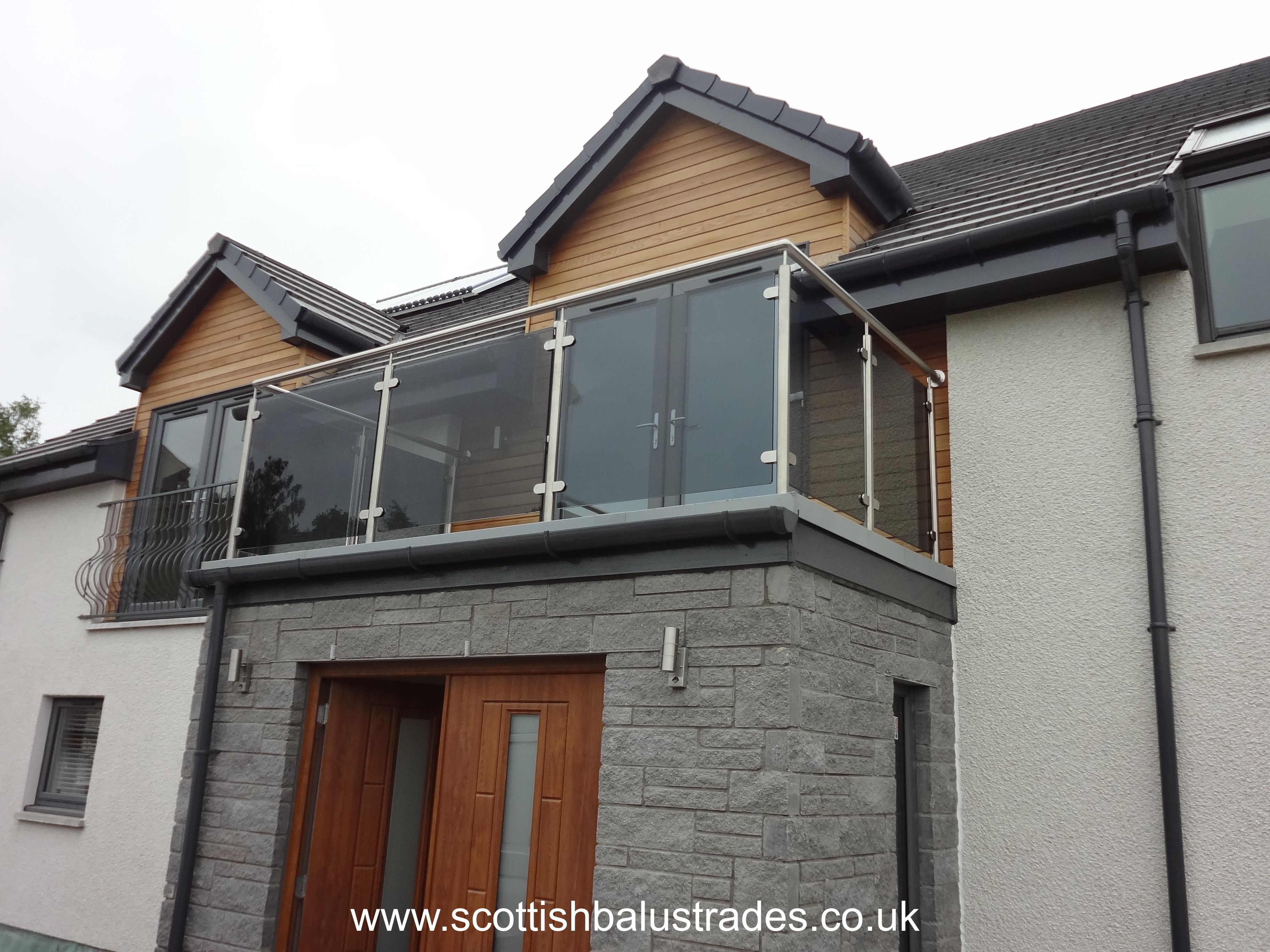 Grey Tinted Glass Balustrade On A Balcony Area Glass Balustrade Glass Balcony Balcony