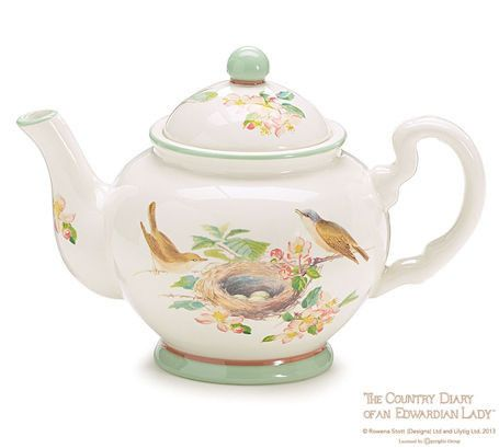 "Ceramic Birds of Olton Teapot in white and mint green trim with a decal design of bird's nest with eggs and birds perched on each side. Microwave and dishwasher safe. 6 1/4""H X 9""W X 5 1/4""D Opening:"