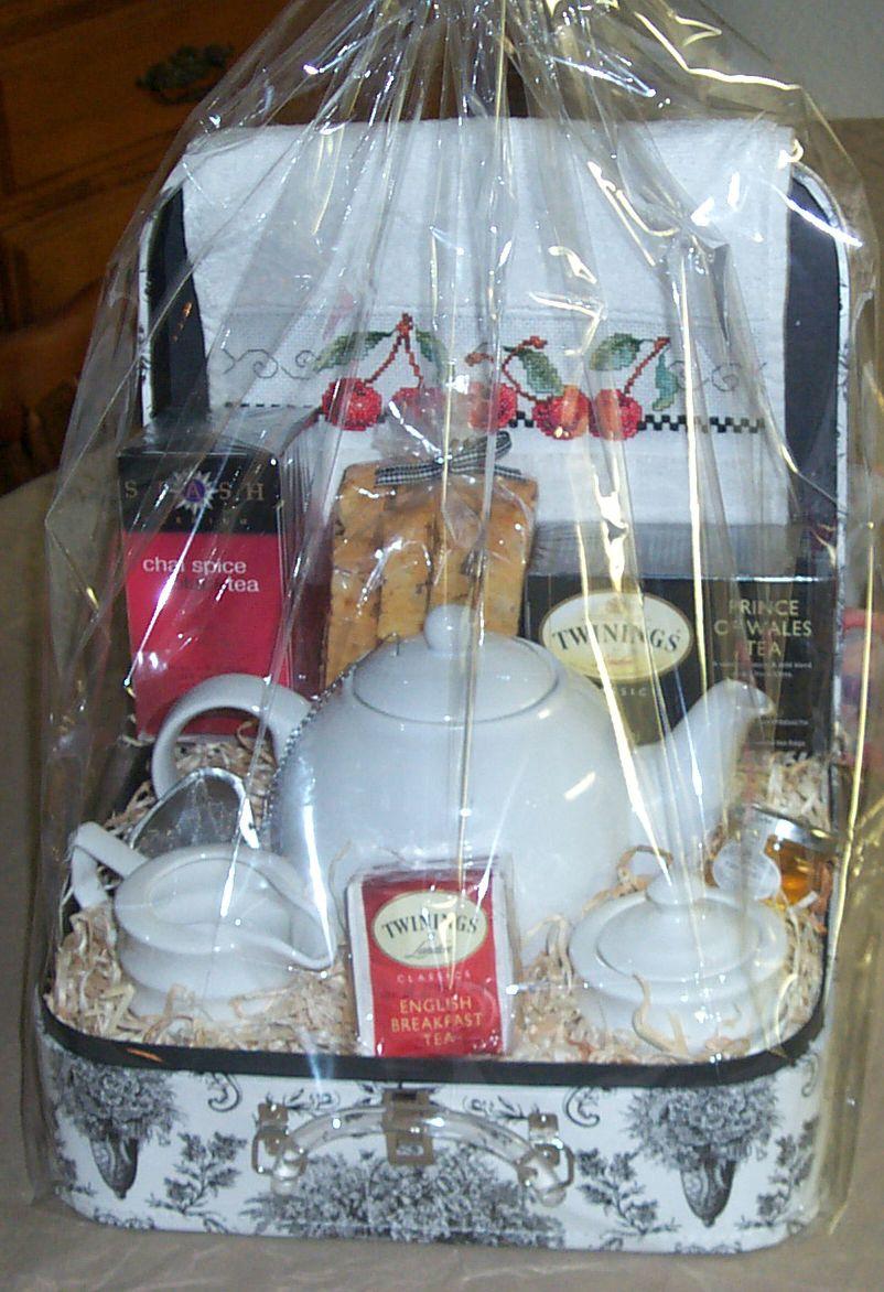 A tea themed gift basket with a hand stitched tea towel