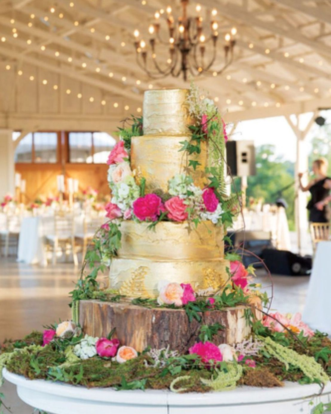 Love the florals and moss surrounding this cake