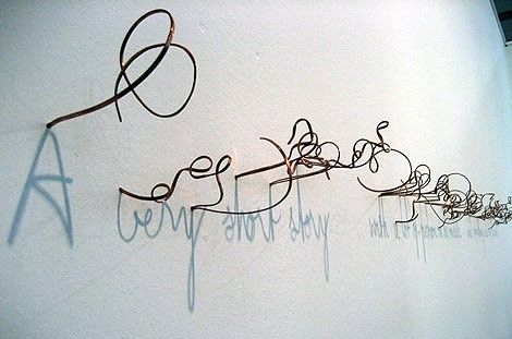 "incredible - the twisted wires create ""handwriting"" shadows on the wall!"