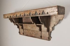 A 19th century hand painted teak wall shelf from the Rajasthan region of India.  This piece would look magical in the right setting, the original paint finish beautifully aged.  Having a pierced galleried solid top with shelved compartments beneath with tapering carved edges and moulding.    Dimensions:  Height: 17 Inches - 43 cm, Width: 40 3/4 Inches - 103.5 cm, Depth: 8 Inches - 20 cm