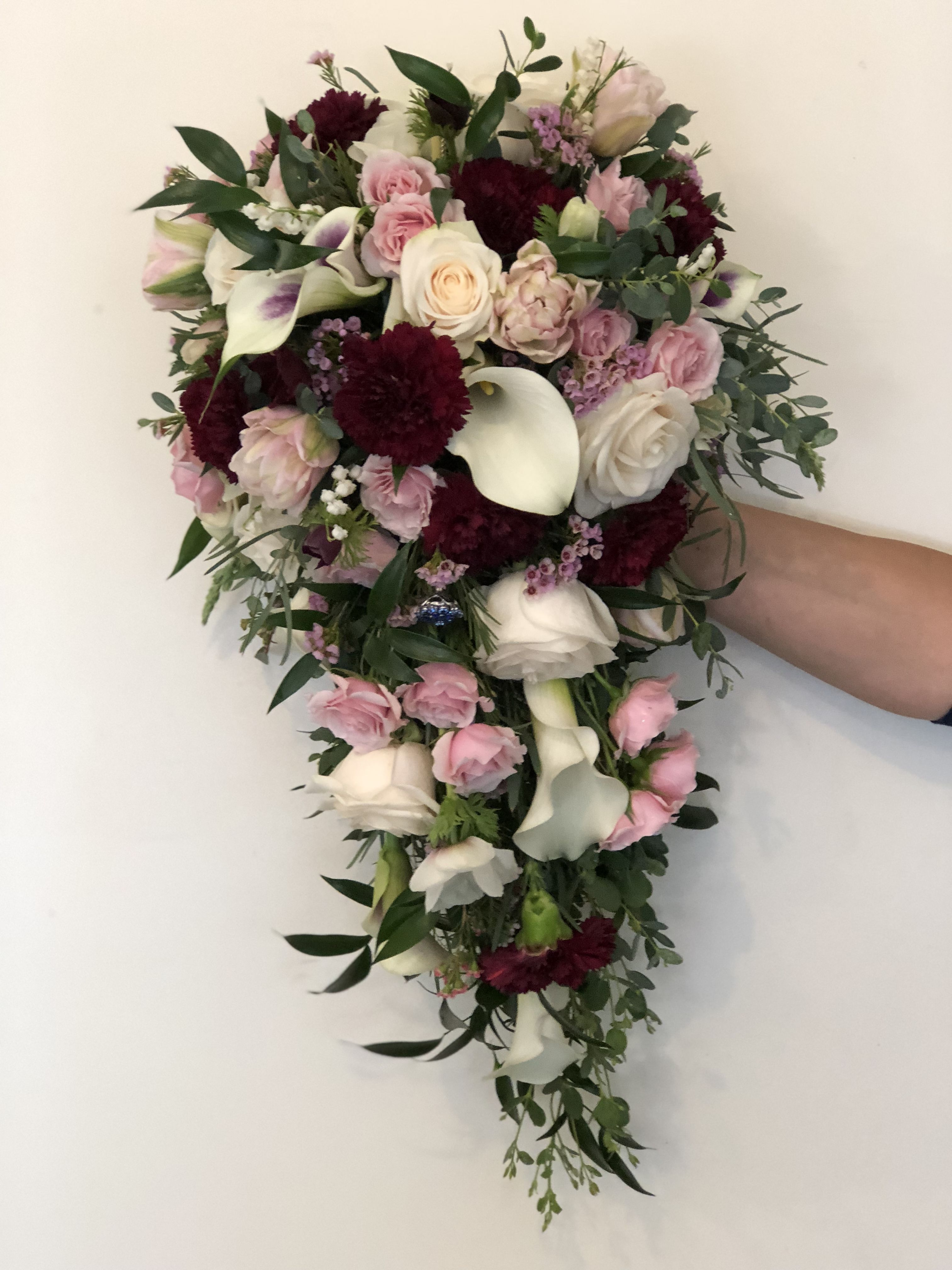 Cascade Bouquet Of Calla Lily Tulips And Roses Merlot And Pink