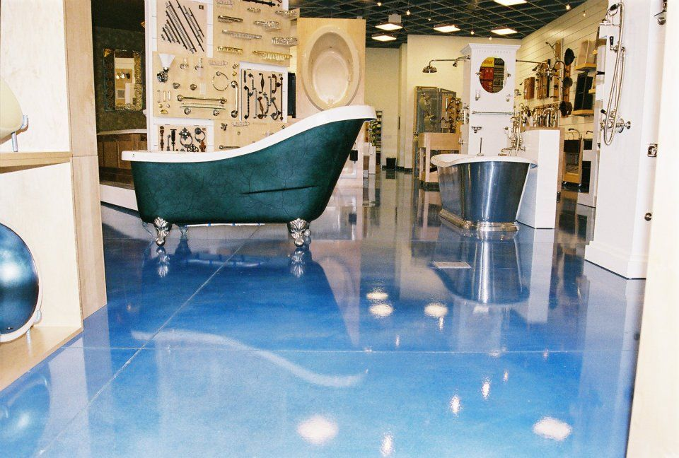 Concrete floor stained blue stained and polished for Decorative concrete floors residential