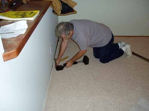 How To Remove Carpet From A Concrete Floor Hunker Carpet Repair Removing Carpet Concrete Floors Diy
