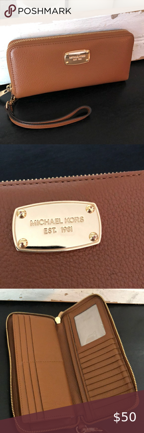 Michael Kors brown leather wristlet wallet Michael Kors camel brown leather wristlet wallet. In nexcellent condition.  Perfect for year round use due to neutral coloring.  Lots of space for credit cards along with zippered pocket for securing smaller things. Michael Kors Bags Wallets
