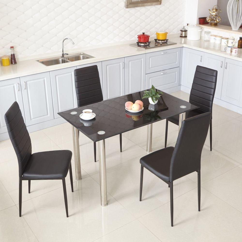 black glass dining table and 4 faux leather chairs