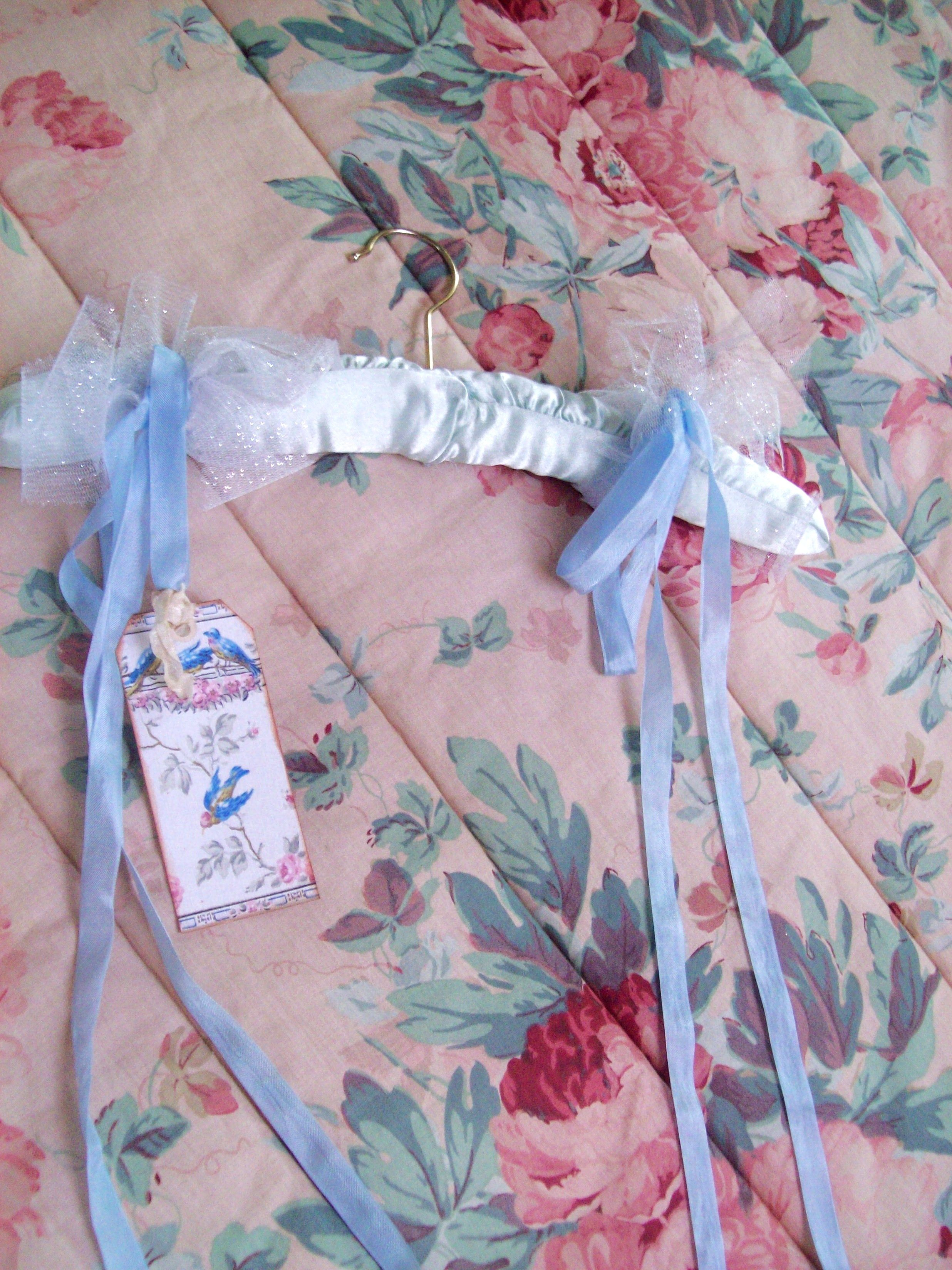 clothes hanger with sweet bluebird tag