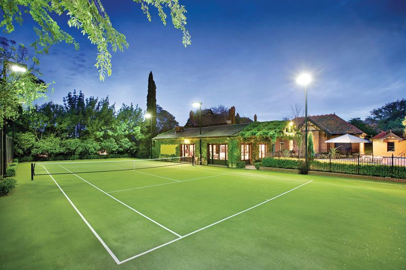 A magnificent synthetic grass tennis court provides the