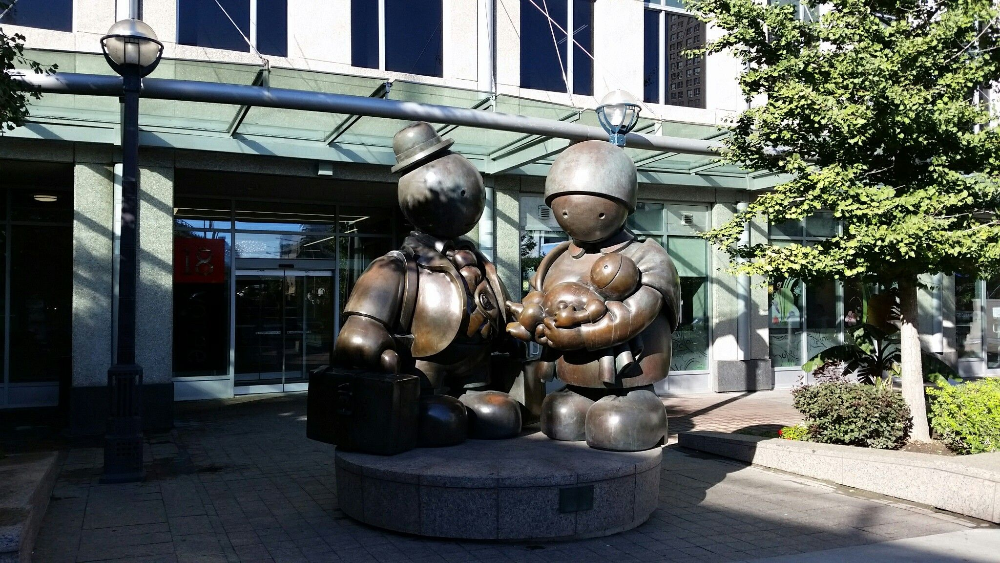 Immigrant Family by Tom Otterness, public art at 18 Yonge Street, Toronto, Canada