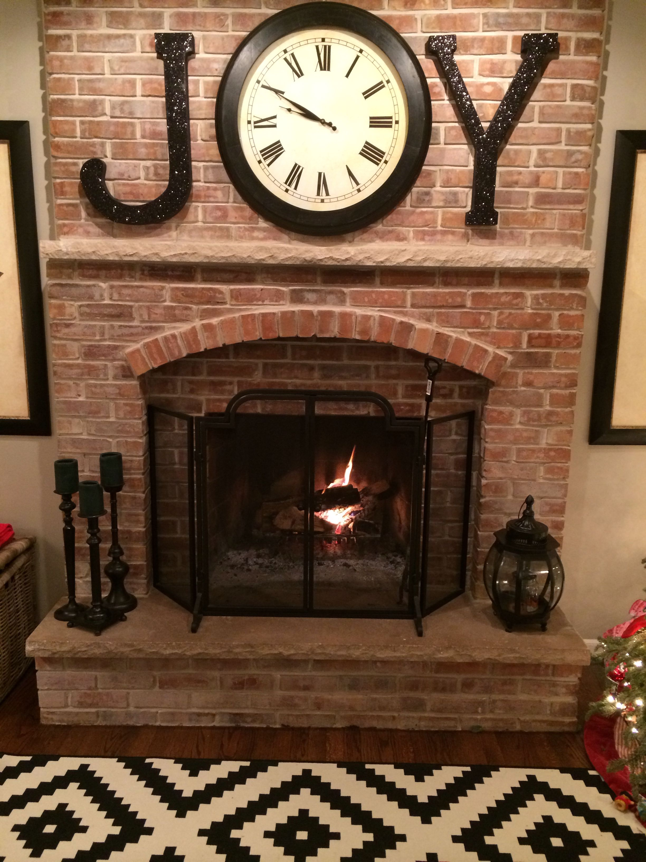 Christmas mantel decor. JOY! Cardboard letters from Joanns spray painted black, brushed with Elmer's glue and a dash of black glitter.