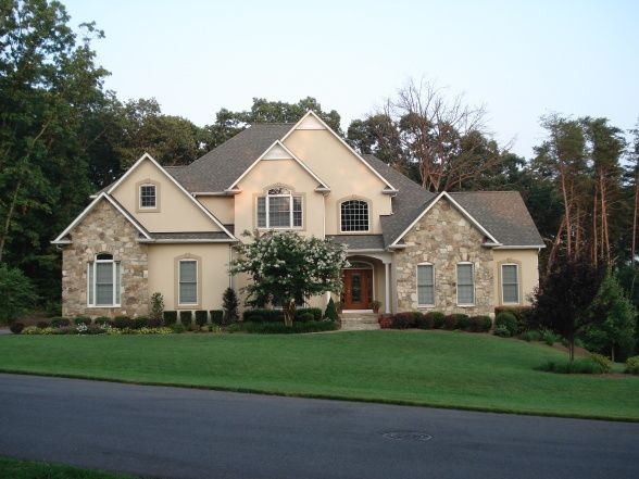 European Inspired Stone And Stucco Retreat House Exterior Stucco Homes House Styles