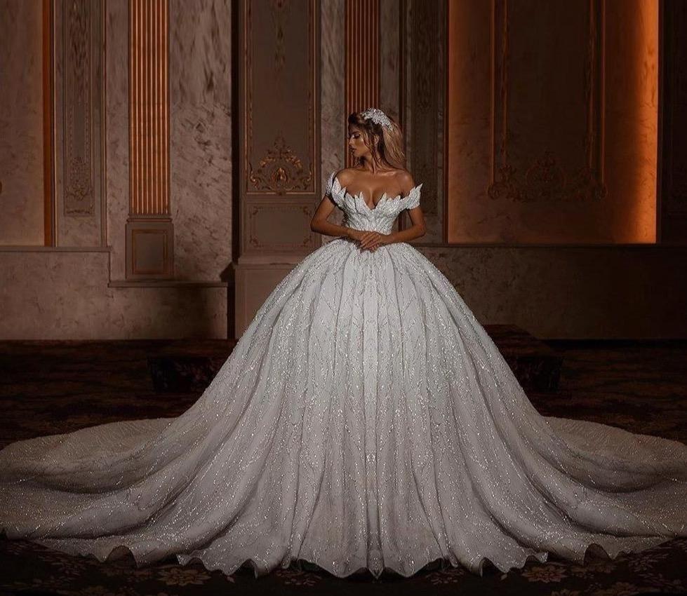 Glitter Off Shoulder Ball Gown Wedding Dresses 2020 Luxury Sparkly Bri Ball Gowns Wedding Ball Gown Wedding Dress Wedding Dresses [ 850 x 979 Pixel ]