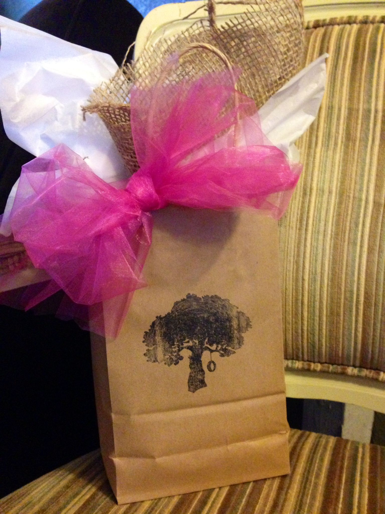 Gift packaging for Valentine's Day...add in a section of burlap with your regular tissue to add a rustic flair and a dash of girly with the pink organza ribbon :) We give attention to detail at Family Tree!