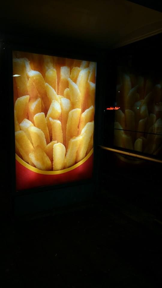 Night time Amsterdam french fries billboard