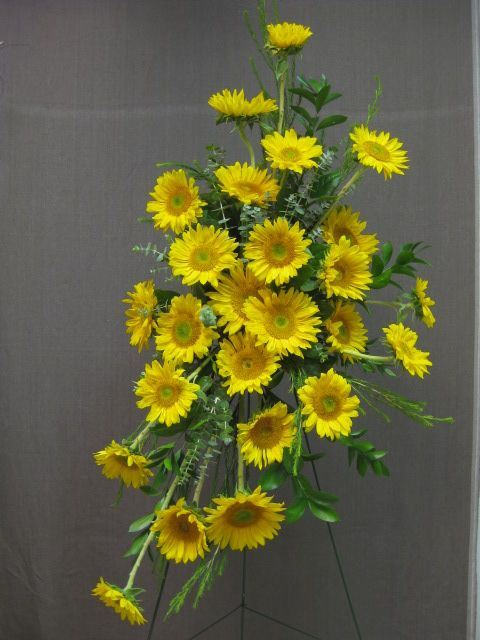 Sunflower standing spray for funeral. #funeralflowers #sunflowers