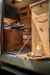 Photo of LIFEforFIVE motorhome expansion-fold-out wooden table on the kitchen element of the Campe …