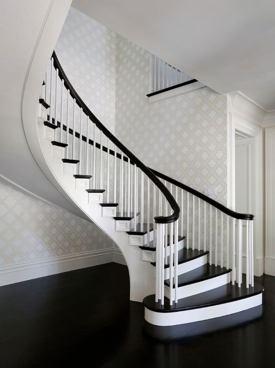Markay Johnson Construction: Stunning Sweeping, Floating Staircase With  Black Handrails And White Spindles.