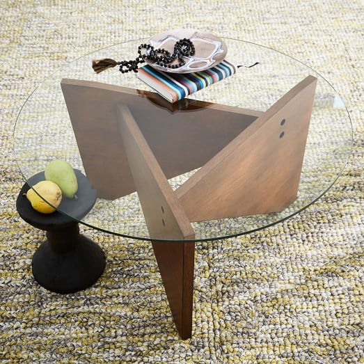 the base of this coffee table takes its cues from nautical sails