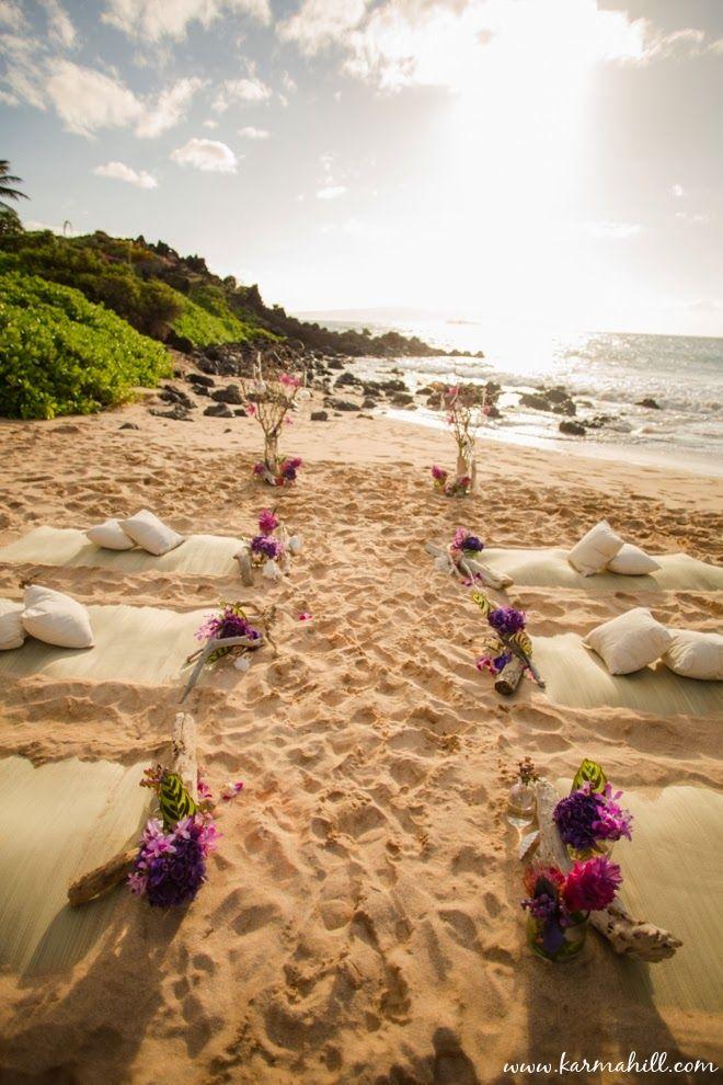 beautiful beach wedding decorations, guest beach mats and pillows   Maui Weddings by Simple Maui Wedding