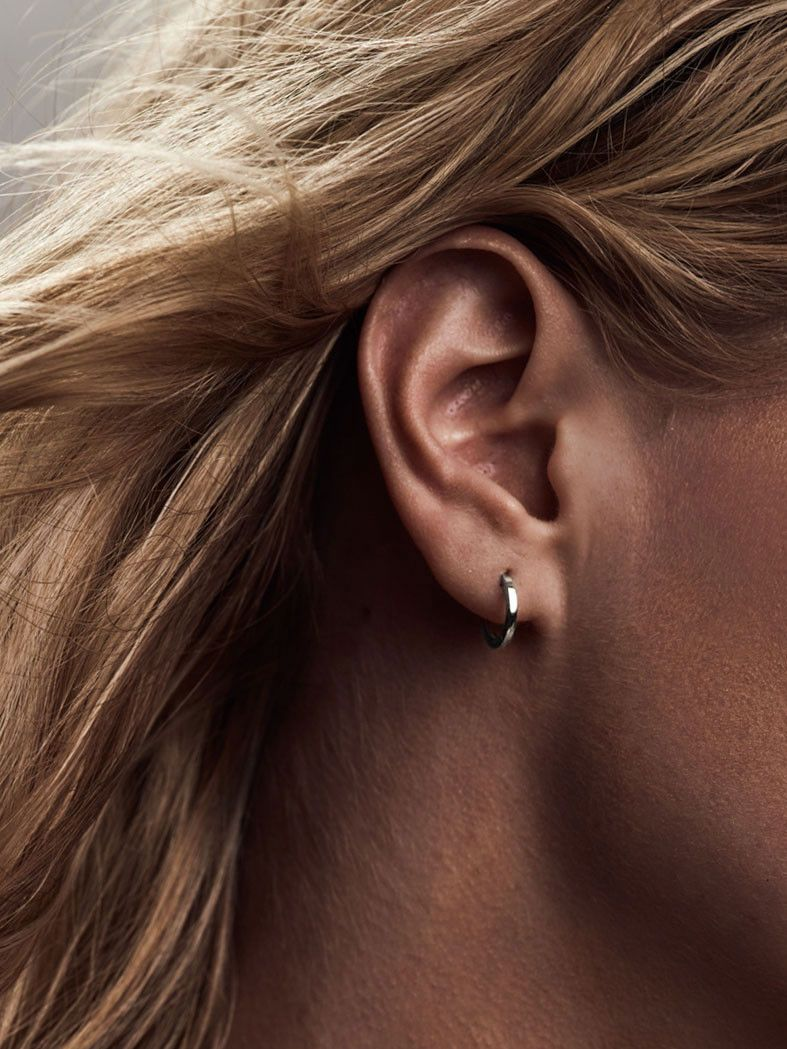 3fde8efb36db37 These super dainty hoop earrings hug your ear lobe for a subtle,  barely-there
