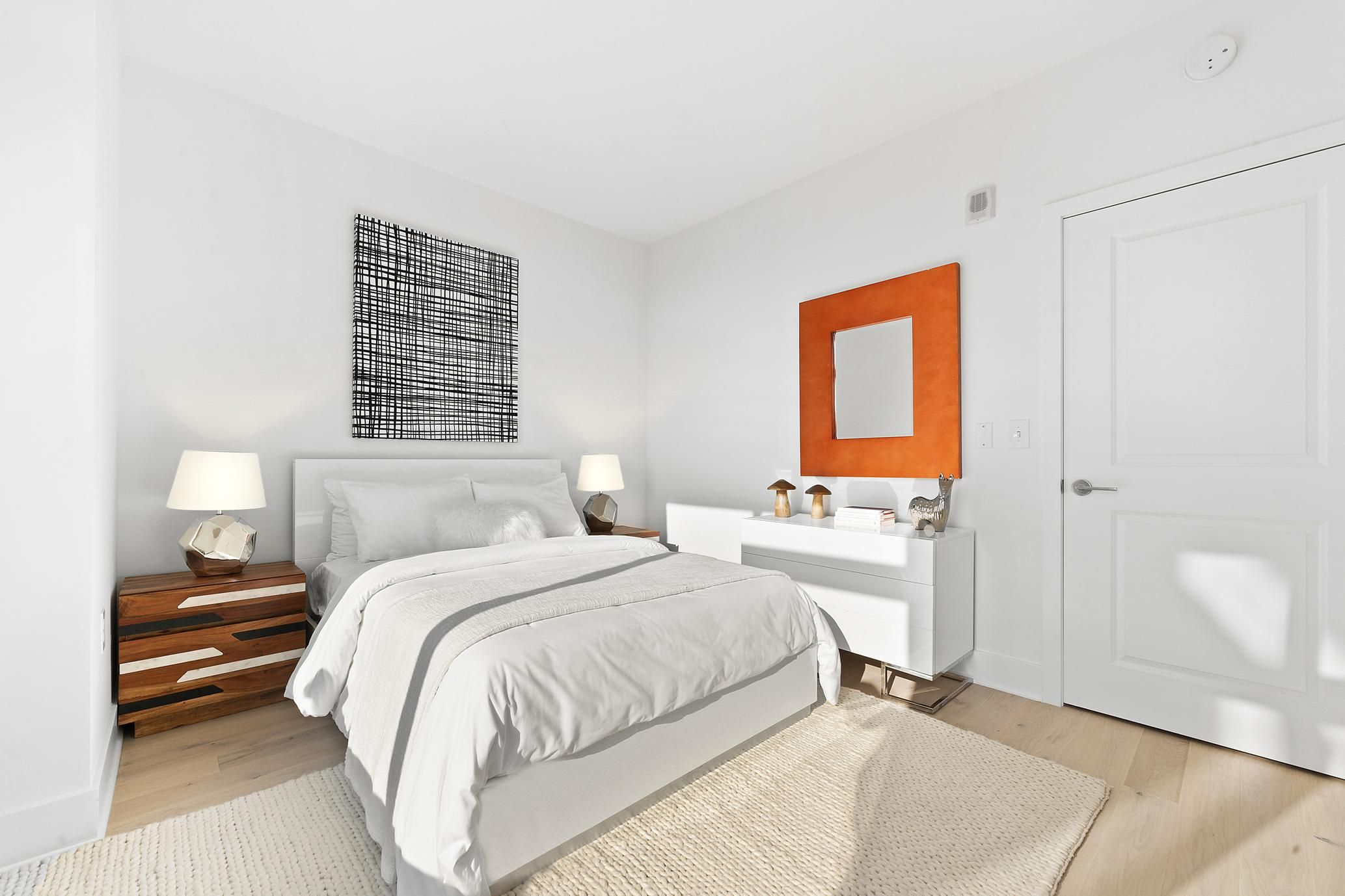 Wake to natural light in a modern bedroom fit for any city