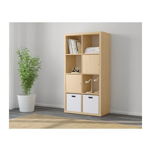 KALLAX Shelving unit - birch effect - IKEA. Only without the doors, two blue boxes instead of the white ones.