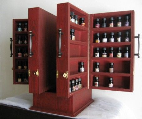 ZOMG! Amazing cabinet...Enabling the BPAL obsession one bottle at a time.