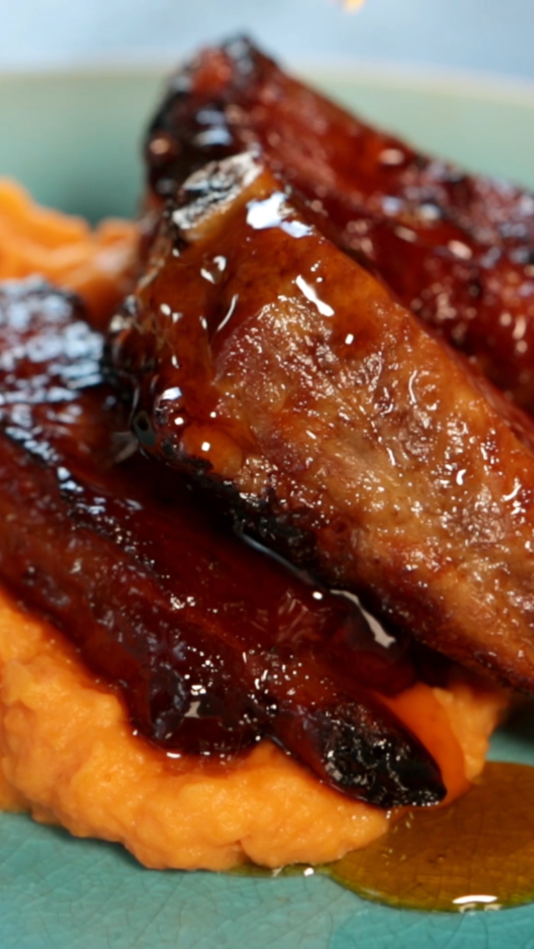 Pork ribs marinated in maple syrup with a side of mashed sweet potatoes