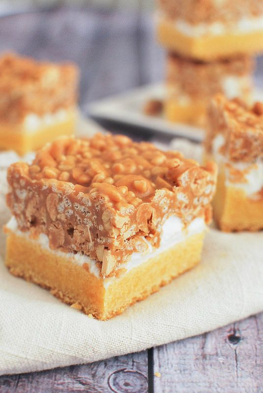 Salted Nut Roll Bars - a cakey bottom layer with a marshmallow center, topped with a crispy peanut butter topping.