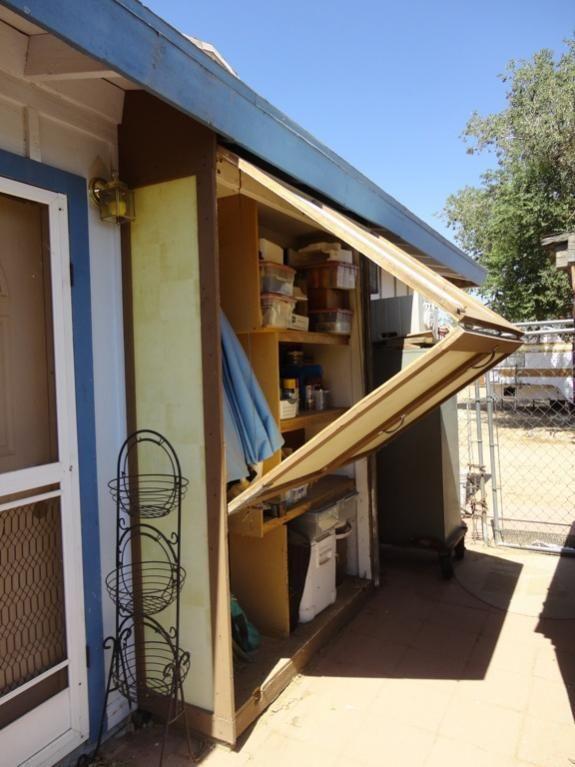 Bifold Garage Doors Mid Raise Beach S To The Right Jpg 575 X 767 73