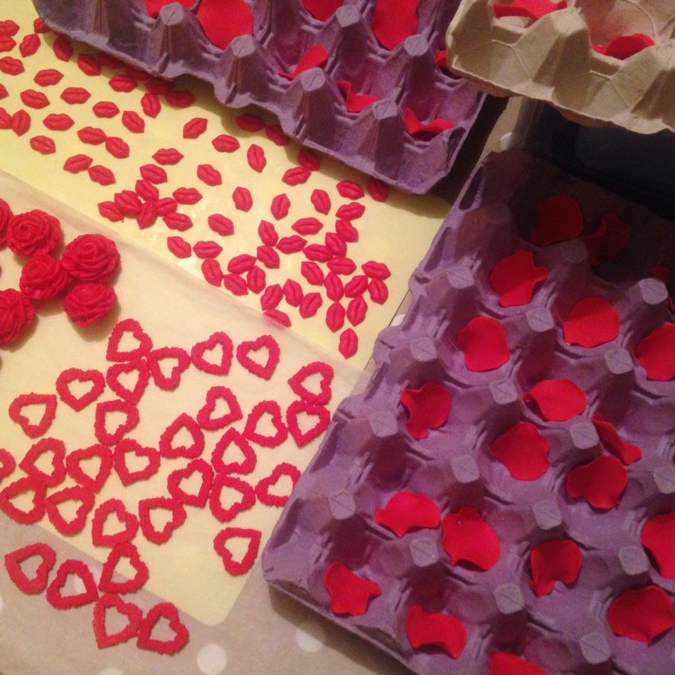 Preparation of hearts, lips, petals and roses for valentines cakes. Pop by and have a look at our Valentine's Day window display cakes