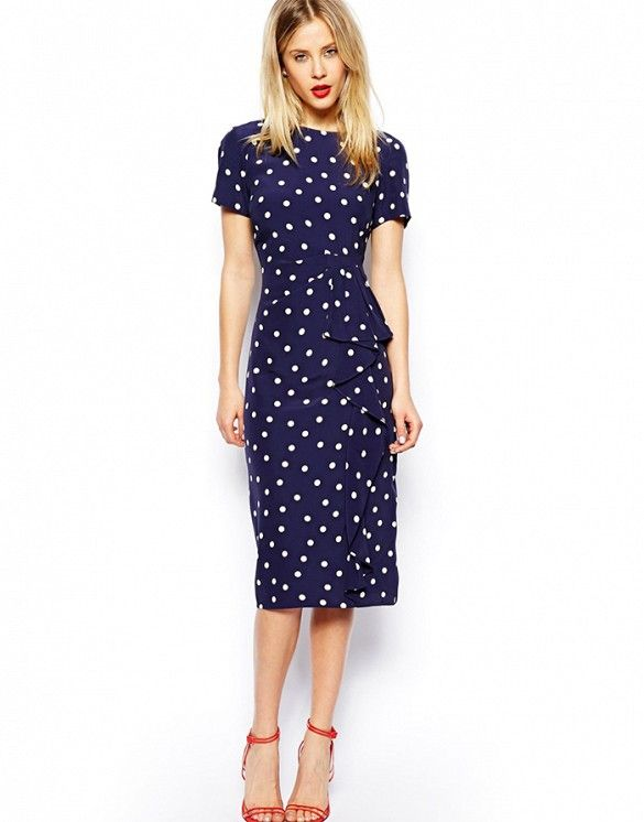 36a60e9f471 Going for a retro look  This polka-dot dress is a must-have.    Pencil  Dress in Spot with Waterfall Skirt in Navy Print by ASOS